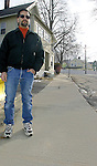 NAUGATUCK, CT -04 JANUARY 2007 -010408DA02- Dan Whitman stands on a $4,000 sidewalk he built in front of his residence in Naugatuck after local officials told him he would be responsible for. Three years later the town is fixing all the sidewalks on his street and ripping up the sidewalk he built.<br /> Darlene Douty/Republican-American