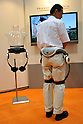 Nobember 9, 2011, Tokyo, Japan - Honda Motor's  &quot;walk assist&quot; device is being demonstrated during the International Robot Exhibition 2011 opened in Tokyo on Wednesday, November 9, 2011. The three-day trade show, sponsored by the Japan Robot Association, was designed promote new products and develop new business through contributing the promotion of new technology. (Photo by Natsuki Sakai/AFLO) [3615] -mis-..