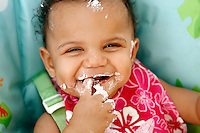 18 May 2008: One year old Luau birthday party for Mason Mangus at her home in Huntington Beach, CA. Messy fun as Mason wipes frosting all over her face as she plays with her cake.