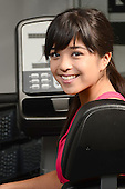 Young attractive Asian woman at the gym