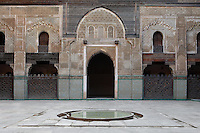 Low angle view of main courtyard, Bou Inania Madrasa, Fez, Morocco, pictured on February 25, 2009 in the morning. The Bou Inania Madrasa was founded as a boarding school and mosque in AD 1351-56 by Abu Inan Faris, also the founder of the Bou Inania Madrasa in Meknes, and holds the status of Grand Mosque. A fine example of Marenid architecture with its intricate plasterwork, carved cedar and decorated tiles or zellij it is the only mosque in Fez open to non-Muslim visitors. It was renovated in the 18th and 20th centuries. Fez, Morocco's second largest city, and one of the four imperial cities, was founded in 789 by Idris I on the banks of the River Fez. The oldest university in the world is here and the city is still the Moroccan cultural and spiritual centre. Fez has three sectors: the oldest part, the walled city of Fes-el-Bali, houses Morocco's largest medina and is a UNESCO World Heritage Site;  Fes-el-Jedid was founded in 1244 as a new capital by the Merenid dynasty, and contains the Mellah, or Jewish quarter; Ville Nouvelle was built by the French who took over most of Morocco in 1912 and transferred the capital to Rabat. Picture by Manuel Cohen.