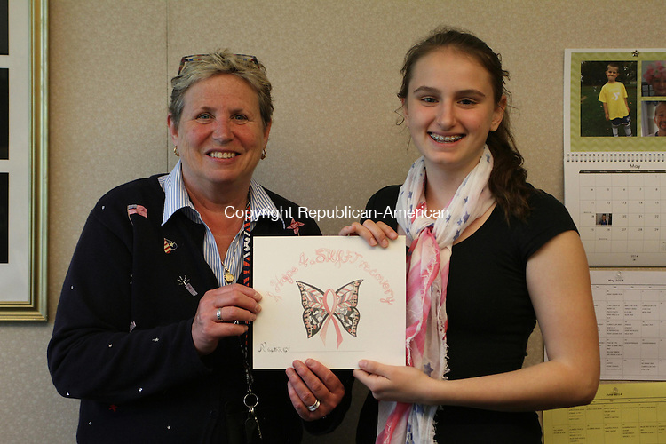 WATERTOWN, CT May 30 2014-053014LW01 - Watertown's Swift Middle School Assistant Principal Mary Jean Mangione, left, poses with eight grade student Diana Ghisa. Ghisa created a butterfly design with a pink breast cancer ribbon in the center in honor of Mangione, who was diagnosed with breast cancer about a year ago. Ghisa made copies of the design and sold it to her classmates for $1. The students donated over $200 to Relay for Life and breast cancer research. The students wrote their names on the bottom of each image and displayed them in the school's lobby when Magione returned in January. &quot;It was very touching and welcoming,&quot; Mangione said. She said she is doing much better now and is working toward getting back to work full time.<br /> Laraine Weschler Republican-American