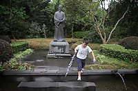 "A young boy within the grounds of the Dujiangyan Irrigation System. The system is regarded as an ""ancient Chinese engineering marvel."" By naturally channeling water from the Min River during times of flood, the irrigation system served to protect the local area from flooding and provide water to the Chengdu basin. Sichuan Province. 2010"