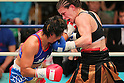 (L to R) Fujin Raika (JPN), Jelena Mrdjenovich (CAN), SEPTEMBER 22, 2011 - Boxing : Jelena Mrdjenovich of canada hits Fujin Raika during the WBC Female Super Feather weight final Elimmination bout at Korakuen, Tokyo, Japan. Jelena Mrdjenovich won the fight on points after ten rounds. (Photo by Yusuke Nakanishi/AFLO) [1090]
