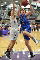 NWA Democrat-Gazette/ANDY SHUPE<br /> Rogers wing Garrett Dake (33) leaps to score past Fayetteville forward Bradon Simon Friday, Feb. 10, 2017, during the second half of play in Bulldog Arena. Visit nwadg.com/photos to see more photographs from the game.