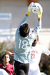 09 November 2010: NC State's Carlos Villa (18) grabs a cross. The North Carolina State University Wolfpack defeated the Virginia Tech Hokies 6-3 at Koka Booth Stadium at WakeMed Soccer Park in Cary, North Carolina in the ACC Men's Soccer Tournament Play-In game.