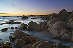 "Sunset on rocky Asilomar Beach. Slow shutter showing the moving tide. Located on the Monterey Peninsula in the city of Pacific Grove, Asilomar (meaning ""a refuge by the sea"") is a narrow one-mile strip of sandy beach and rocky coves."
