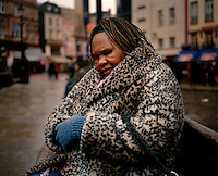 """62 year old Anie from Angola sits on a bench in London's Leicester Square. Anie spent her childhood in DR Congo where due to her father's political connections to the Angolan political party UNITA, she was imprisoned, tortured and raped. She has difficulty walking because her legs are so badly scarred from her torture injuries and they still cause her a great deal of pain. She has been destitute since April 2008 and sometimes sleeps outside and sometimes on friends' floors. """"My life here in England is full of pain and distress,"""" she says. """"It's hard for me to walk and I desperately need some accommodation. If I'm lucky friends give me GBP 10 a week to live on but sometimes I have nothing."""" Anie is one of an estimated 300,000 rejected asylum seekers living in the UK."""