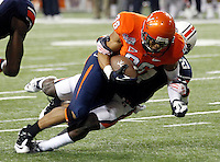 ATLANTA, GA - DECEMBER 31: Ray Keys #86 of the Virginia Cavaliers is tackled by Robenson Therezie #27 of the Auburn Tigers during the 2011 Chick Fil-A Bowl at the Georgia Dome on December 31, 2011 in Atlanta, Georgia. Auburn defeated Virginia 43-24. (Photo by Andrew Shurtleff/Getty Images) *** Local Caption *** Robenson Therezie;Ray Keys