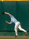 06/16/2006 University of North Carolina right fielder Seth Williams runs down a Cal State Fulerton fly ball during game 2 of the College World Series in Omaha Nebraska Friday evening..(photo by Chris Machian  /Prairie Pixel Group)