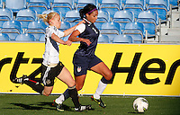 US's Sydney Leroux fights for the ball with Germany's Leonie Maier during their Algarve Women's Cup soccer match at Algarve stadium in Faro, March 13, 2013.  .Paulo Cordeiro/ISI