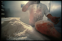 Salting Parma Ham, Langhirano, Italy - Photograph by Owen Franken
