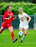 14 October 2010: University of Vermont Catamount midfielder Caitlin McGowan, a Senior from Rye, NY, keeps the ball away from University of Hartford Hawks' forward/midfielder Raelynn Mikell, a Freshman from Gilbertsville, PA, at Centennial Field in Burlington, Vermont. The Hawks defeated the Lady Cats 6-2 in America East play. Mandatory Credit: Ed Wolfstein Photo