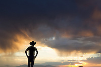 silhouette of a cowboy against a dramatic sky in New Mexico