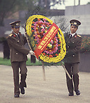 Goose stepping guards carry a donated floral weath to Ho Chi Ming's marble tomb on Dien Bien Phu Street in Hanoi, North Vietnam.  (Jim Bryant Photo)....