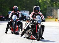May 19, 2014; Commerce, GA, USA; NHRA pro stock motorcycle rider Eddie Krawiec (right) after defeating teammate Andrew Hines during the Southern Nationals at Atlanta Dragway. Mandatory Credit: Mark J. Rebilas-USA TODAY Sports