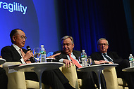 """Washington, DC - April 21, 2017: World Bank President Jim Yong Kim  speaks at the""""Financing for Peace"""" panel discussion during the annual Spring Meetings of the IMF/World Bank Group at the IMF headquarters in the District of Columbia April 21, 2017, as European Commission President Jean-Claude Juncker and United Nations Secretary General Antonio Guterres look on. (Photo by Don Baxter/Media Images International)"""