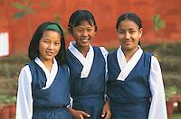 Clementown Tibetan Settlement. Girls watching the Dalai Lama consecrating Buddha.