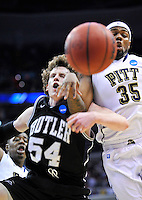 Matt Howard of the Bulldogs and Panthers' Nasir Robinson collide while going after the loose ball. Butler upset no.1 seed Pittsburgh 71-70 during the 3rd round of the NCAA Tournament at the Verizon Center in Washington, D.C on Saturday, March 19, 2011. Alan P. Santos/DC Sports Box