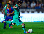 FC Barcelona's Lionel Messi scores during the Spanish league football match Levante UD vs FC Barcelona on April 14, 2012 at the Ciudad de Valencia Stadium in Valencia. (Photo by Xaume Olleros/Action Plus)