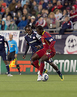 Real Salt Lake midfielder Jean Alexandre (12) attempts to control the ball as New England Revolution midfielder Shalrie Joseph (21) pressures. In a Major League Soccer (MLS) match, Real Salt Lake defeated the New England Revolution, 2-0, at Gillette Stadium on April 9, 2011.