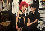 Punk girl with red hair shop assistant in Boy boutique 153 Kings Road, Chelsea London  England 1983