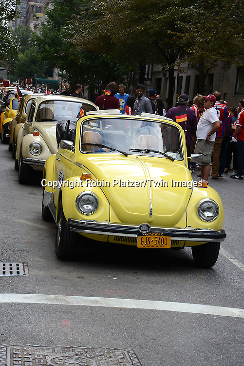 VW Cars  marchs in the Steuben Parade on Fifth Avenue in New York City on September 20. 2014. <br /> <br /> photo by Robin Platzer/Twin Images<br />  <br /> phone number 212-935-0770