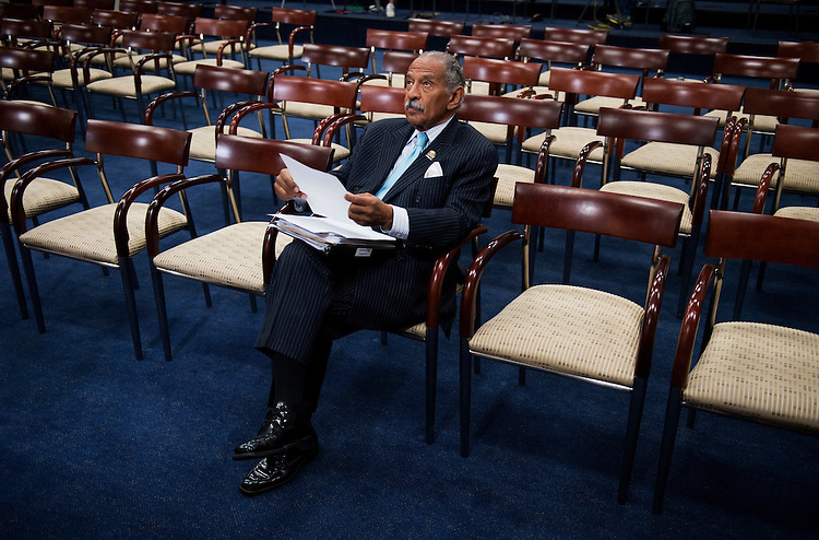 UNITED STATES - AUGUST 01:  Rep. John Conyers, D-Mich., waits for the start of a Congressional Progressive Caucus news conference in the Capitol Visitor Center to introduce the Deal for All.  The resolution would address policies that protect the middle class such as social security, medicare and medicaid, and address corporate loopholes that allow companies to pay less in taxes.  (Photo By Tom Williams/CQ Roll Call)