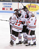 The Huskies celebrate 6'7 Jamie Oleksiak's (Northeastern - 6) first college goal which gave them a 2-1 lead. - The visiting Rensselaer Polytechnic Institute Engineers tied their host, the Northeastern University Huskies, 2-2 (OT) on Friday, October 15, 2010, at Matthews Arena in Boston, MA.
