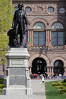 Toronto (ON) CANADA - April 24 2008 File Photo<br /> Statue of MacDonald in front of the Legislative Assembly of Ontario in<br />  Queens Park ( in the Downtown area of Toronto)<br /> <br /> <br />  Opened in 1860 by Edward, Prince of Wales, it was named in honour of Queen Victoria. The park is the site of the Ontario Legislature, which houses the Legislative Assembly of Ontario, and so the phrase Queen's Park is also frequently used to refer to the Government of Ontario.