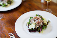 SOUTH EGREMONT, MA - JUNE 17, 2014: Thinly sliced discs of 'Lambcetta' top a salad at John Andrews Farmhouse Restaurant. Chef Dan Smith cures and smokes locally-sourced lamb belly for his take on Italian pancetta. CREDIT: Clay Williams.<br /> <br /> <br /> &copy; Clay Williams / http://claywilliamsphoto.com