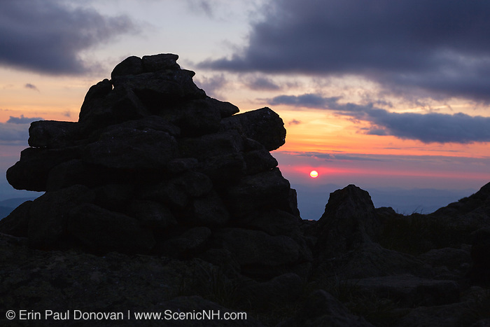 Silhouette of rock cairn at sunset along the Appalachian Trail near Mount Clay in the White Mountains, New Hampshire USA during the summer months.