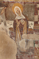 Detail of the Annunciation : Mary standing and listening to angel Gabriel (not pictured), 12th century frescoes in the choir of the Pre-Romanesque Chapel of Saint Martin de Fenollar (Sant Marti de Fenollar), 9th century, Maureillas Les Illas, Pyrenees Orientales, France. The frescoes are an outstanding piece of work, which greatly impressed modern artists, especially Pablo Picasso and Georges Braque in 1910. Picture by Manuel Cohen