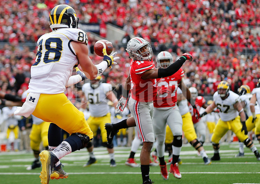 Michigan Wolverines tight end Jake Butt (88) catches a touchdown pass in the first quarter the college football game between the Ohio State Buckeyes and the Michigan Wolverines at Ohio Stadium in Columbus, Saturday morning, November 29, 2014. As of half time the Ohio State Buckeyes and Michigan Wolverines were tied 14 - 14. (The Columbus Dispatch / Eamon Queeney)