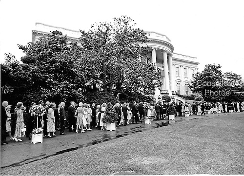 Washington, DC - June 12, 1971 -- Invited guests leave the Rose Garden of the White House to return to the State Floor in Washington, D.C. on Saturday, June 12, 1971 following the wedding ceremony of Tricia Nixon and Edward Cox.           .Credit: Bill Allen / CNP