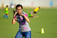 A young Peruvian girl practices shadowboxing while training in the outdoor boxing school at the Telmo Carbajo stadium in Callao, Peru, 4 April 2013.