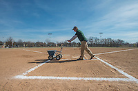 NWA Democrat-Gazette/ANTHONY REYES @NWATONYR<br /> Bobby Hinton, with the Bentonville Parks and Recreation department, lays chalk lines Friday, Feb. 10, 2017 at the softball fields at Memorial Park in Bentonville. The park is hosting the University of Arkansas-Monticello DII Softball Challenge this weekend. The park will host another softball tournament next weekend, the 2017 UAM 8-State Classic.