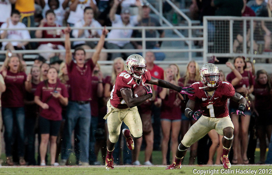 TALLAHASSEE, FL 10/13/12 FSU-BC1013012 CH -Florida State's Lamarcus Joyner, left, and Tyler Hunter get ready to run after Joyner pulled down an interception during first half action against Boston College Saturday at Doak Campbell Stadium in Tallahassee. .COLIN HACKLEY PHOTO
