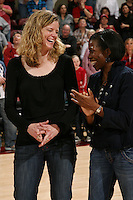 STANFORD, CA - FEBRUARY 7:  Members of the 1990 National Championship team reunite during Stanford's 77-39 win over USC on February 7, 2010 at Maples Pavilion in Stanford, California. Pictured are Trisha Stevens and Angela Taylor.