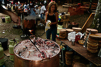 Octopus festival goes thru 20,000 KG of Octopus and 70,000 people attend even though the front page of the local paper talks about how quotas will have to be cut by 20 to 50 percent this year because they are pulling too much out of the ocean...Pulpeiras (women who cook octopus) are mostly one family.  83 year old (stirring 2nd pot in background octopus sticking out of pot in foreground) is Maria Justo  988 272663 and blonde with short hair is Xonxa Gonzalez Hermida 66 25 91 96.  Woman with pony tail in same group is Elena Gonzalez Quintela 988 272617...Guy in early morning with blue shirt rearranging octopus in tubs while tents are being set in the background is Sergio Gonzalez Valeiras 679 609 281...Octopus fishing has been going for centuries (party is officially from 1962).  The monks were landlords of the area and the port and fishermen had to pay a tribute in fish and octopus.  This village dried the octopus for the monks...Boy sitting alone waiting to eat octopus is David Giraldez Pereira 968 33 62 71...Main contacts for this festival are:.Mayor of town is:  Mr. de Montes 619 91 99 72.Man in charge is Gustavo Ledo 988 27 47 57