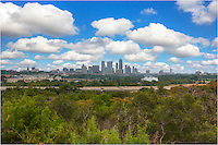 "This is the view of downtown Austin and the Texas State Capitol you have from near the Zilker Park Clubhouse on the west side of MoPac (highway 1).  This photograph of the capitol city of Texas was taken on a ""Chamber of Commerce"" September afternoon."