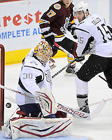 San Antonio Rampage goaltender Jacob Markstrom (30) makes a save as Rampage's Eric Selleck looks on during the first period of an AHL playoff hockey game against the Chicago Wolves, Saturday, April 21, 2012, in San Antonio. (Darren Abate/pressphotointl.com)