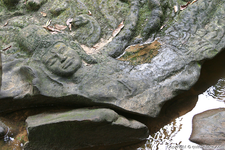Kbal Spean, valley of a 1000 Lingas, Cambodia. Is an Angkorian era site on the southwest slopes of the Kulen Hills in Cambodia, 25 km from the main Angkor group. The motifs for the stone carvings are roughly three: myriads of lingams, depicted as neatly arranged bumps that cover the surface of a rock; lingam - yoni designs; and various Hindu mythological motifs, including depictions of gods and animals.
