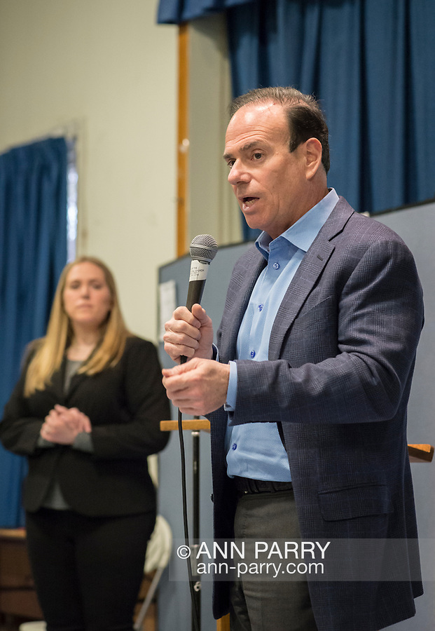 Wyandanch, New York, USA. March 26, 2017. JAY JACOBS, Chairman of Nassau County Democratic Committee, speaks at Politics 101 event, the first of series of activist training workshops for members of TWW LI, the Long Island affiliate of national Together We Will.  At left is SUE MOLLER, a TWWLI administratoR.