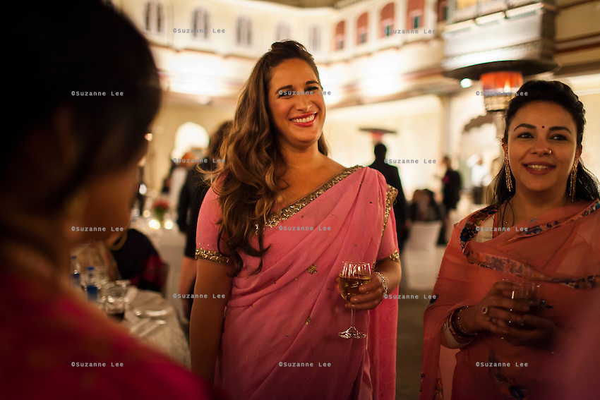 Australian violinist Niki Vasilakis shares a conversation with a group of women at the OzFest Gala Dinner in the Jaipur City Palace, in Rajasthan, India on 10 January 2013. Photo by Suzanne Lee