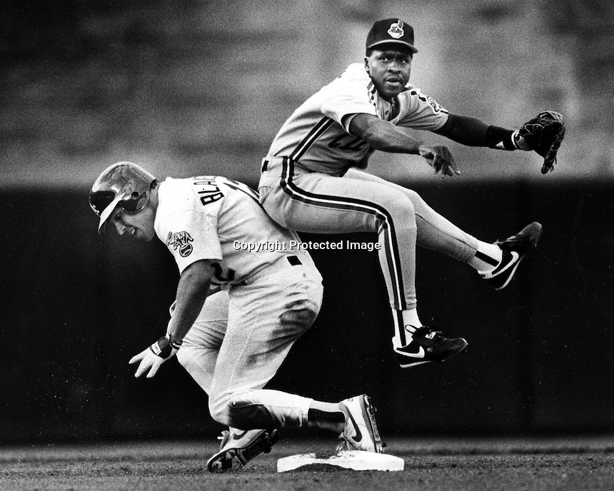 Oakland Athletics Lance Blankenship breaking up double play against the Cleveland Indians. <br />