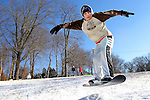 WATERBURY, CT 01 December 2008-010109SV01--Tyler Morotto, 12, of Waterbury borrowed a friends snowboard to try a jump at Fulton Park in Waterbury. Morotto was enjoying the show covered hill with about a dozen other sledders and snow boarders Thursday.<br /> Steven Valenti Republican-American