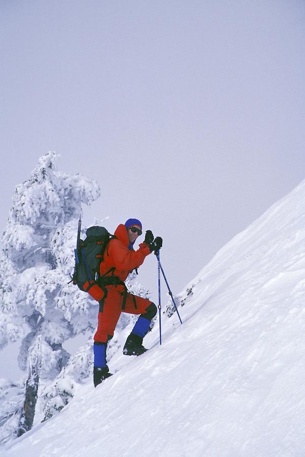 Man climbing in snow, Washington Cascade Mountains