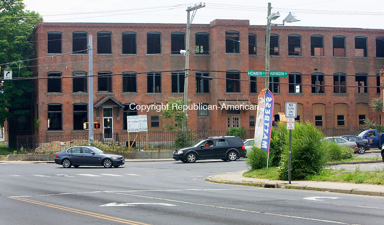 WATERBURY CT. 11 June 2015-061115SV06-Meridian Atlantic Properties of Cheshire is knocking down an old factory at the corner of Huntington and Thomaston avenues with plans to build a Cumberland Farms store and gas station and retail building of some sort at that site.<br /> Steven Valenti Republican-American