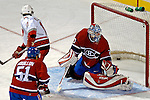 6 February 2007: Montreal Canadiens goaltender David Aebischer of Switzerland is unable to stop the Carolina Hurricanes from scoring the winning goal in the third period at the Bell Centre in Montreal, Canada. The Hurricanes went on to defeat the Canadiens 2-1.....Mandatory Photo Credit: Ed Wolfstein *** Editorial Sales through Icon Sports Media *** www.iconsportsmedia.com